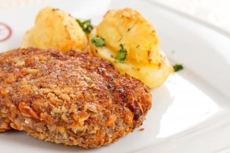 breaded pork chop: schnitzel with potatoes