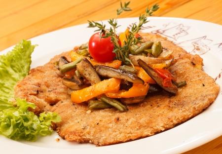 breaded pork chop: Schnitzel with vegetables Stock Photo