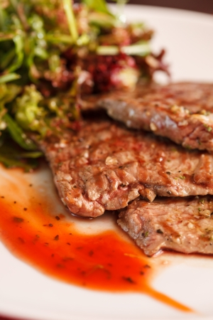 new york strip: steak with salad