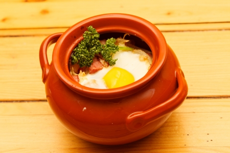 meat with egg in the pot Stock Photo - 20579659