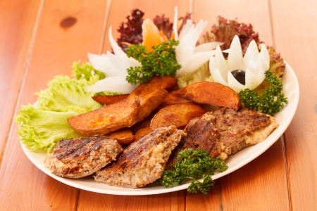 grilled ribs with vegetables photo