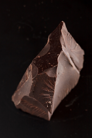 cocoa powder: chocolate on black background Stock Photo