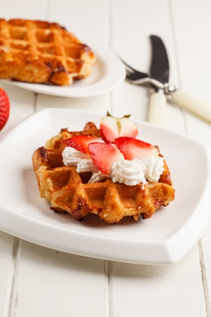 belgian waffles with fresh strawberries and whipped cream photo