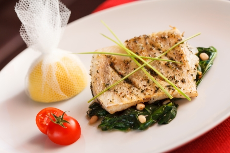 white fish with spinach photo