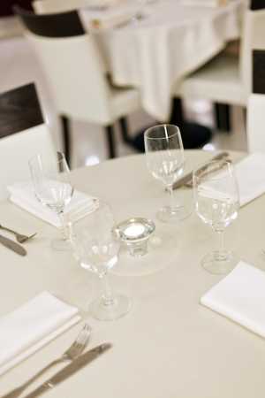 Tables set for meal photo