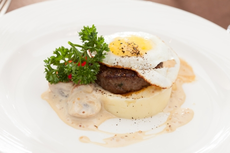 fried egg with steak and potatoes photo