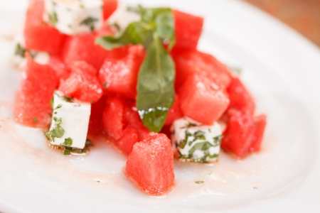 watermelon salad with feta cheese with and basil  photo