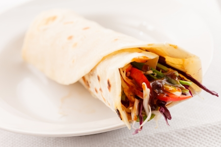 tortilla with meat and vegetables photo
