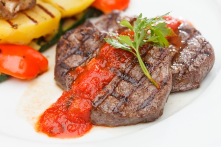 Grilled steak with baked vegetables photo