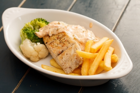 chicken breast with french fries photo