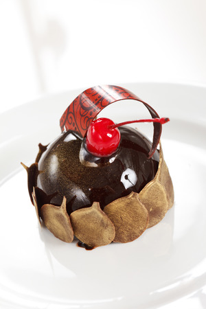 chocolate pastry with cherry photo