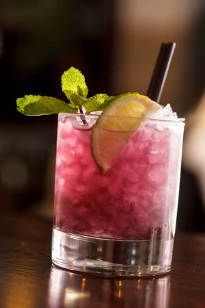 bramble: cocktail with blackberries and straw Stock Photo