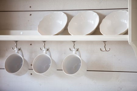 kitchen ware: opened cupboard with kitchenware inside Stock Photo