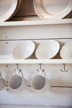 opened cupboard with kitchenware inside Stock Photo