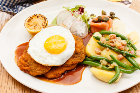 Wiener Schnitzel with Potatoes and Fresh Vegetables photo