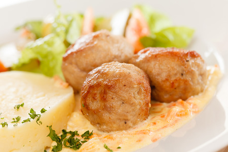 meat balls with mashed potatoes and vegetables photo