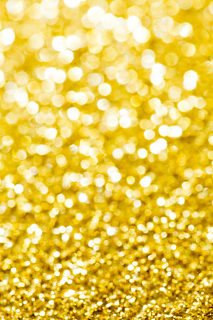 Abstract holidays golden lights on background photo