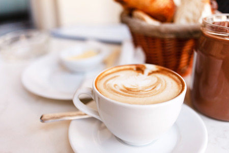 cappuccino with croissants photo