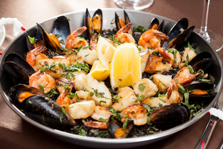 valencia orange: seafood paella in the fry pan Stock Photo