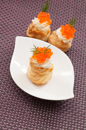 stuffed fish: Puff pastry with cream cheese and caviar Stock Photo