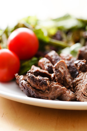 Salad with Sliced Beef and Cherry Tomato photo