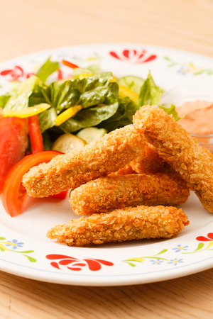 fish fingers with vegetables photo