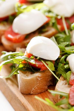 Tomato, mozzarella and arugula sandwich photo