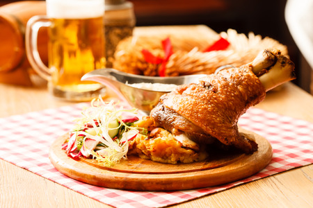 eisbein with braised cabbage, salad and beer Stock Photo - 31267576
