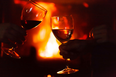 glass of  wine beside the fire photo