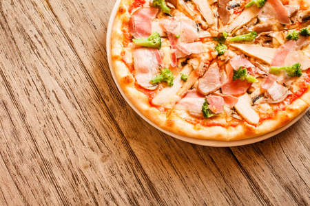 pizza on wooden background photo
