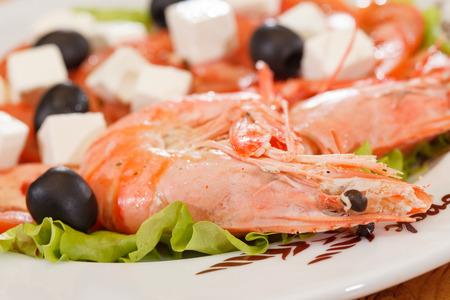 shrimps with greek salad photo