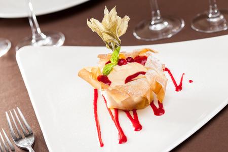 confiserie: berries with vanilla cream baked in dough