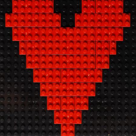 plastic bricks: Heart of red plastic bricks