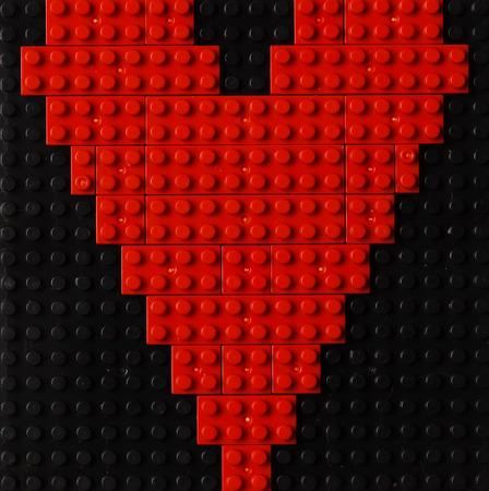 Heart of red plastic bricks photo