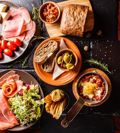 italian salami: Spanish dinner cooked and served on the table Stock Photo