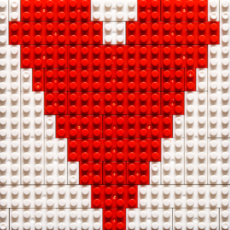 child s block: Heart Shape created from building toy bricks