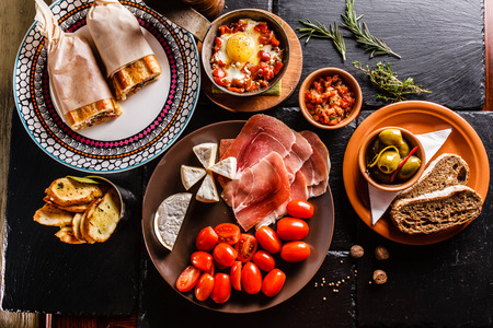 gourmet dinner: Spanish dinner cooked and served on the table Stock Photo