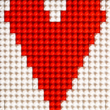 plastic bricks: Heart from plastic bricks Stock Photo