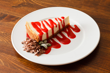 cheesecake: cheesecake with strawberry sauce