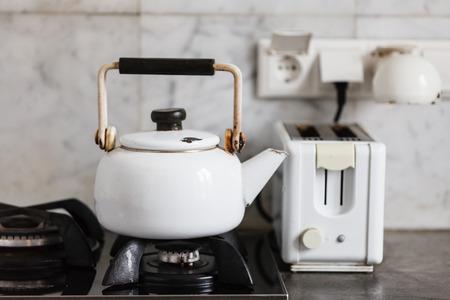 Kettle heats the gas stove photo