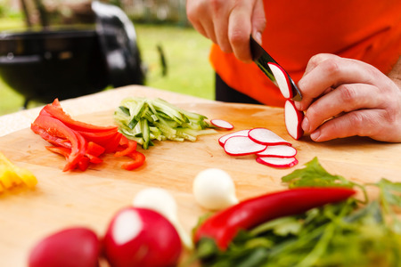cutting vegetables: man cutting vegetables Stock Photo