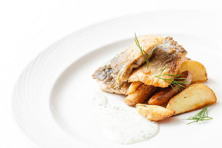 fried fish with potatoes photo