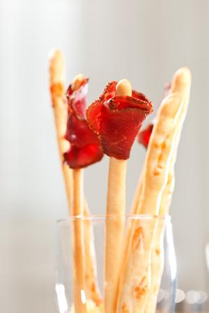 breadstick: bread-stick with parma ham Stock Photo