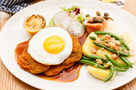 schnitzel: Wiener Schnitzel with Potatoes and Fresh Vegetables
