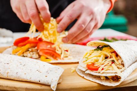 burrito: chef making tortilla