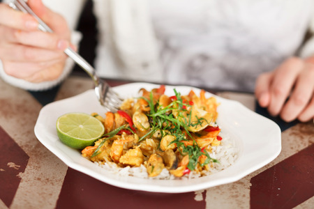 woman eating curry