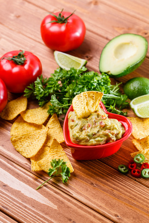 cilantro: Guacamole with avocado, lime, tomato, and cilantro