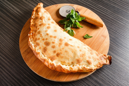 pizza: calzone pizza Stock Photo