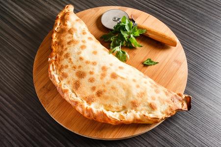 comida italiana: la pizza calzone
