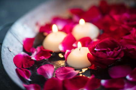 candle: red roses and candles Stock Photo